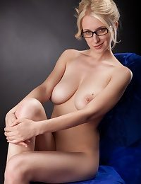 Busty blonde teacher posing naked wearing just her glasses