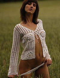 Wearing a cack-handed crocheted vapid cardigan, Rita exudes a confident and gorgeous disclose as she flaunts her willowy physique on the vast crop field.